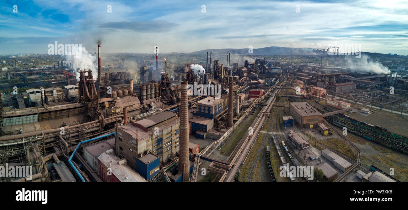 Extremely close aerial drone view of blast furnaces of metallurgical plant; heavy industry of high-strength rolling metal; one of the largest steel pl - Stock Image