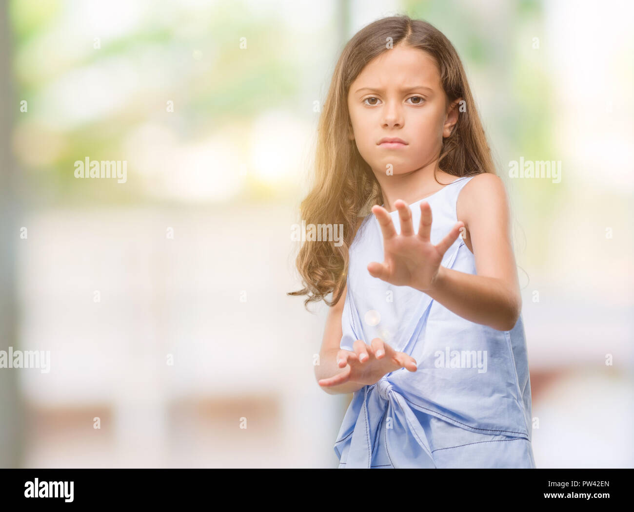 brunette hispanic girl disgusted expression displeased and fearful