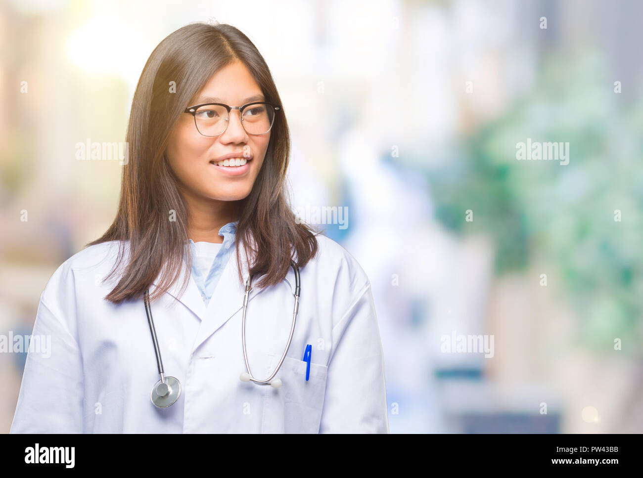 Young asian doctor woman over isolated background looking away to