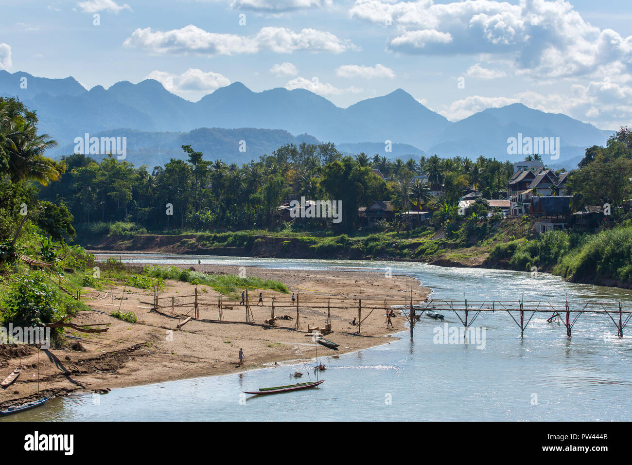 Wooden bridge over Nam khan rive in Luang Prabang, Laos - Stock Image
