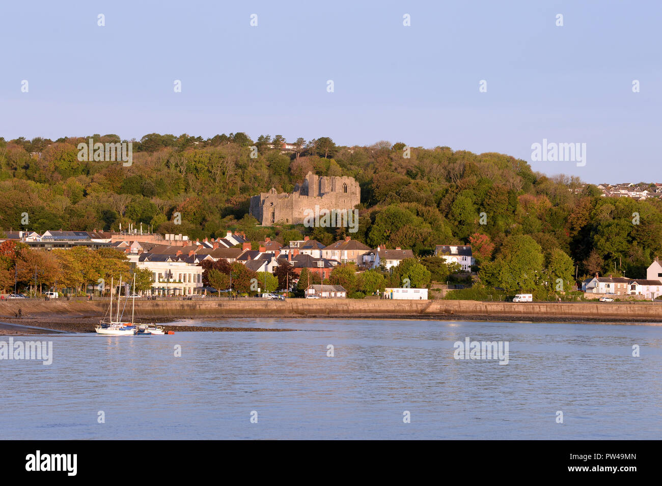 Autumn in The Mumbles. Several yachts await removal from the water for the Winter. The ruins of Oystermouth castle preside over this seaside village. Stock Photo