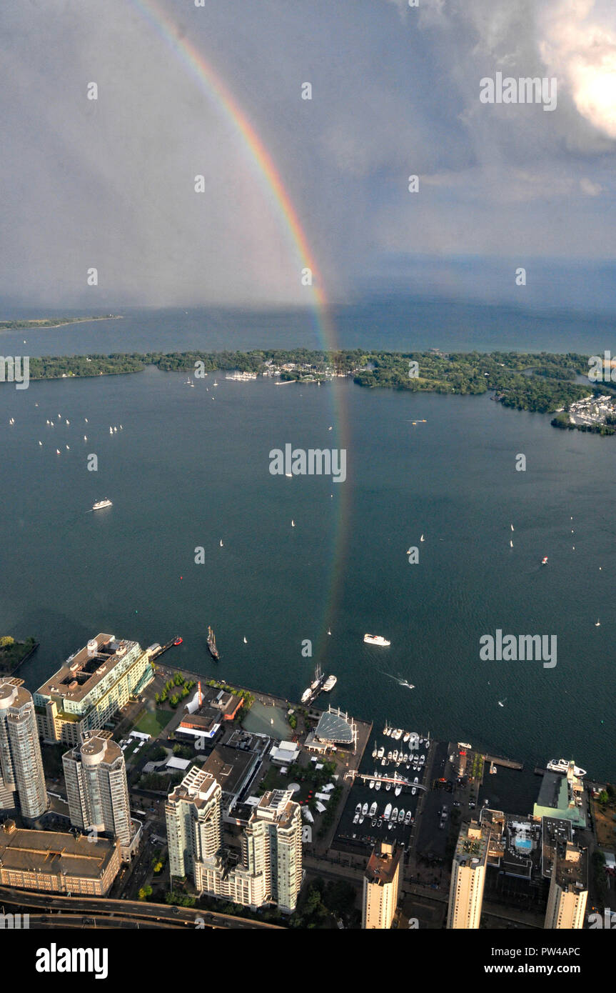 Rainbow over Toronto harbour Front - Stock Image