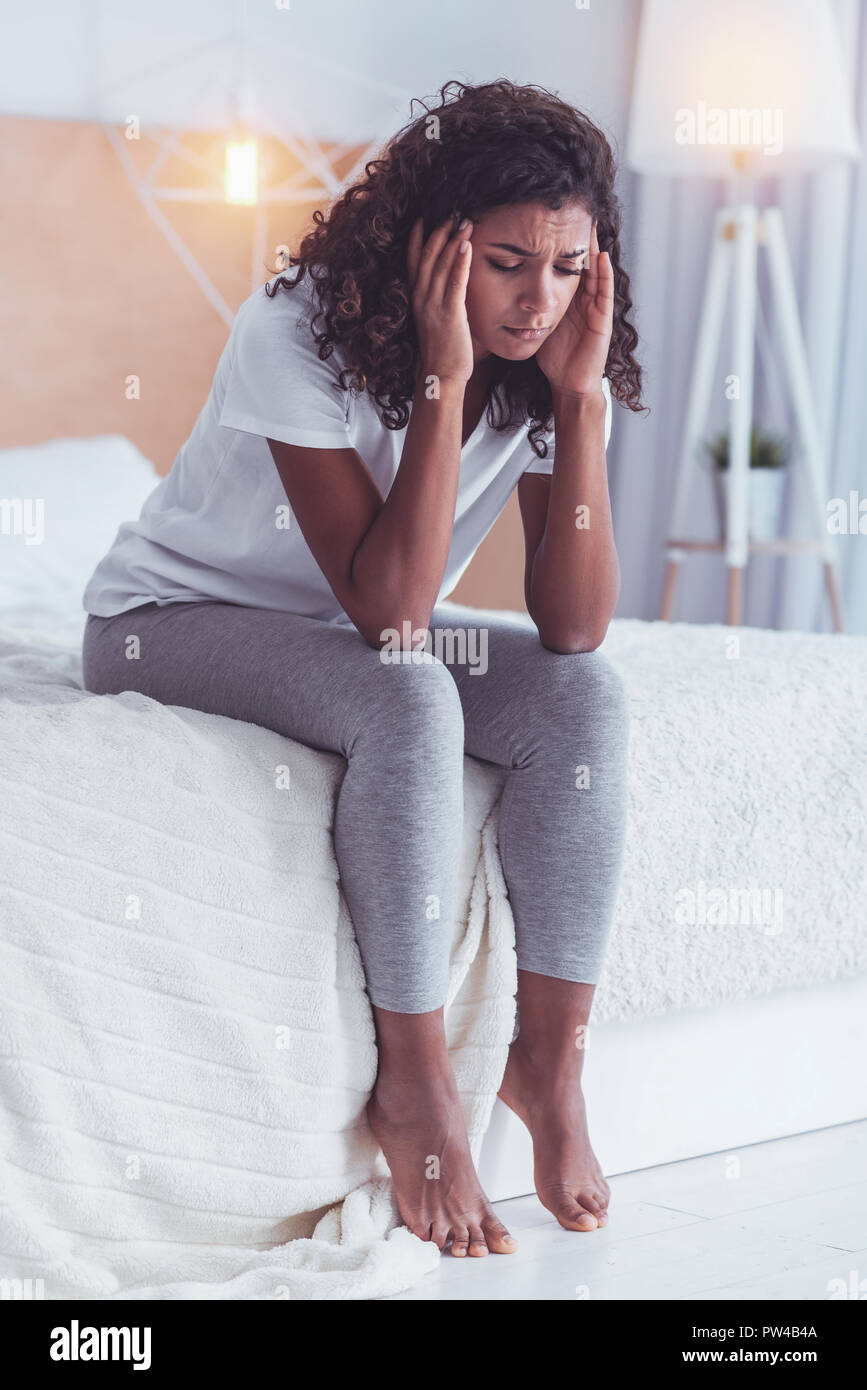 Young woman feeling awful after breakup with boyfriend - Stock Image