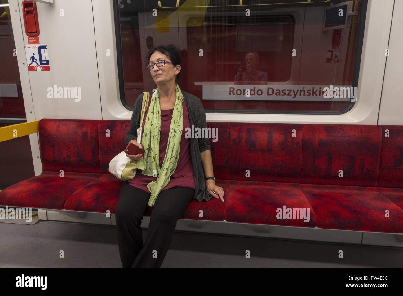 The Warsaw Metro  has upholstered seats in its train cars. - Stock Image