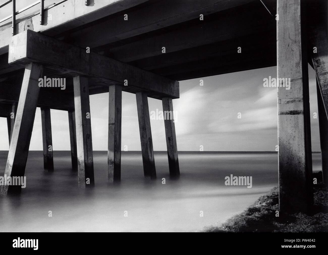 Long exposure of Atlantic Sea near a dock at Pompano Beach, Florida, USA - Stock Image