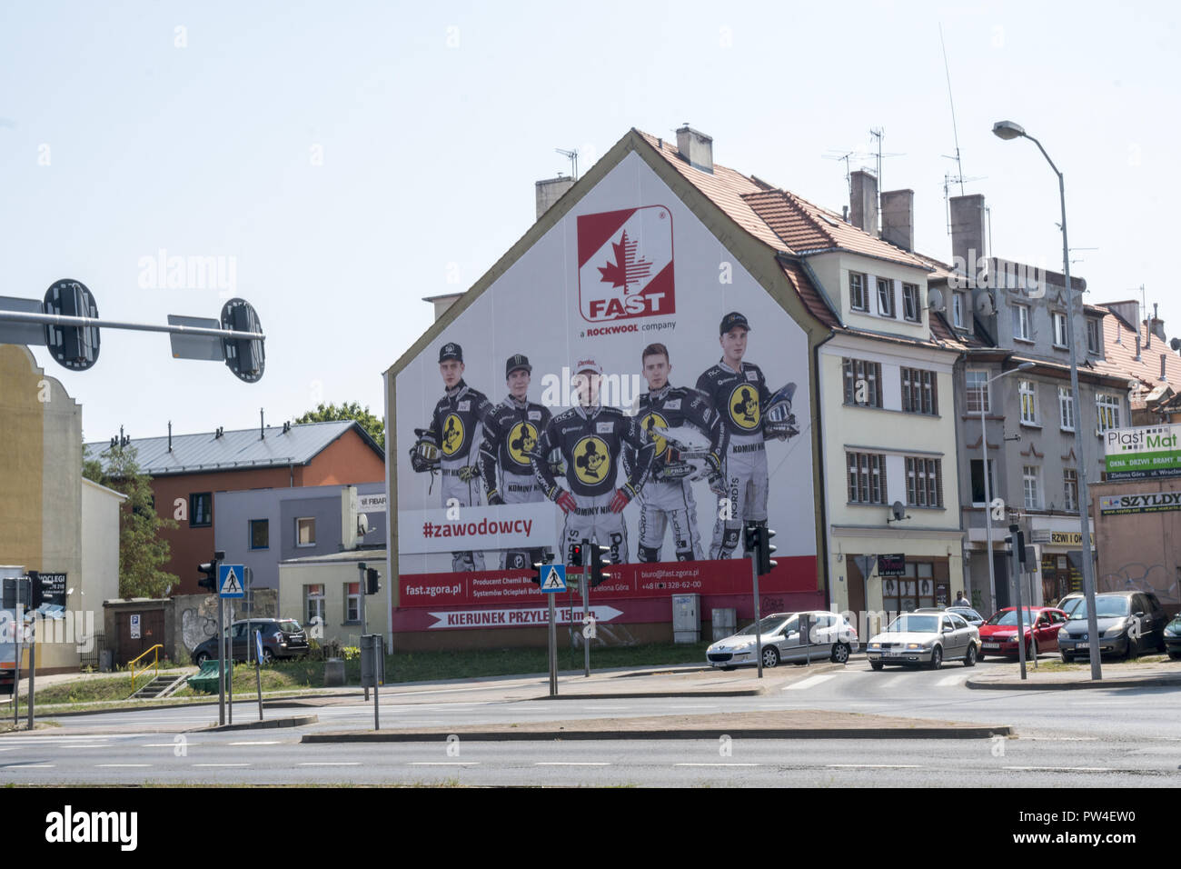 Famous Speedway motorcycle racers on a billboard ad on a building in Zielona Gora, Poland. Speedway racing is a very popular sport in Poland. - Stock Image