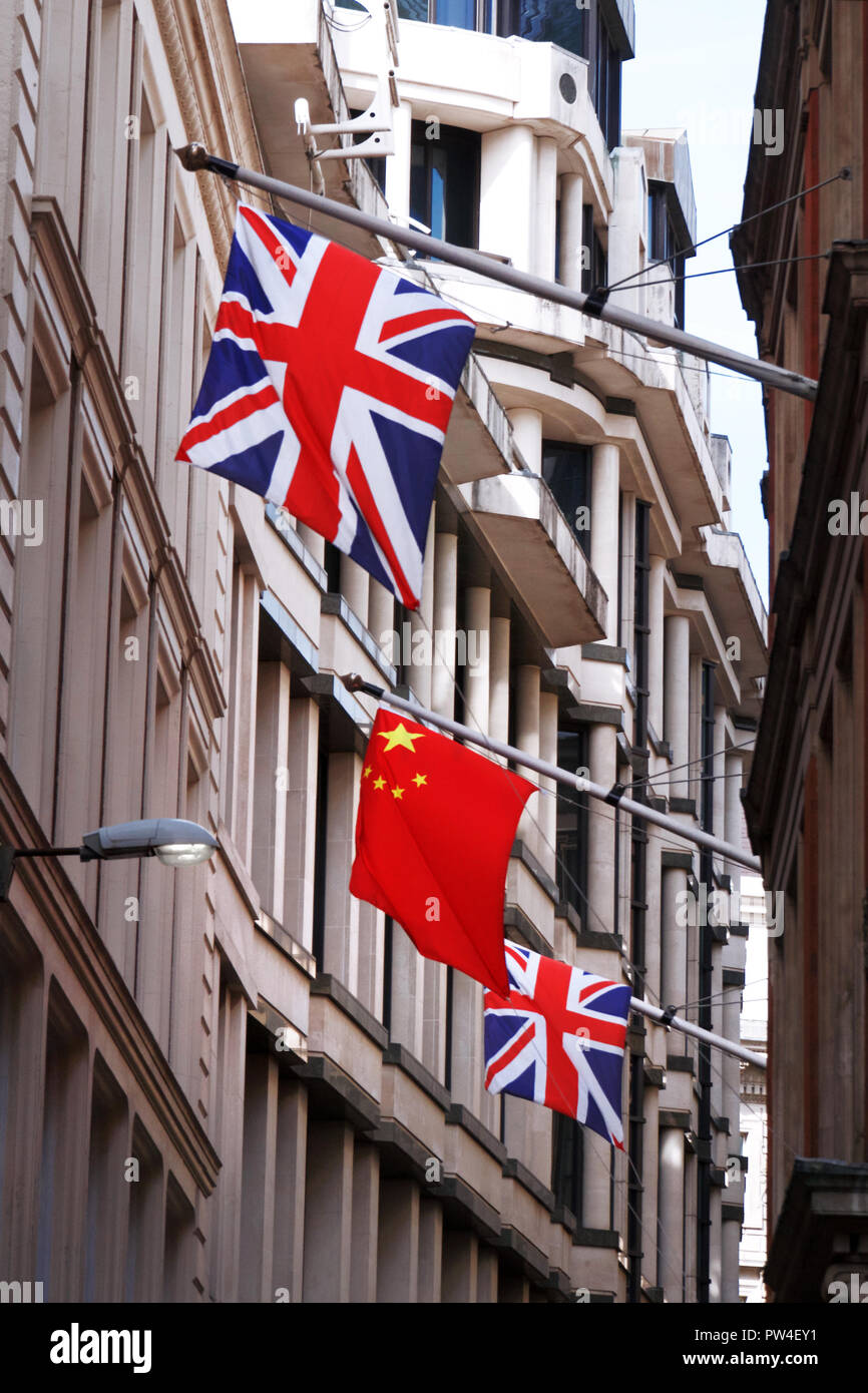 British and Chinese flags flying together - Stock Image
