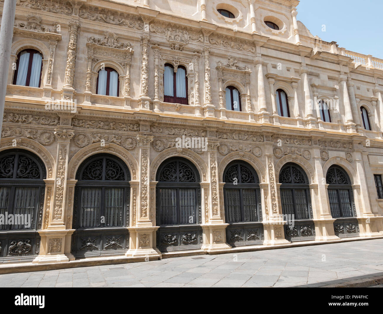 The Casa Consistorial of Seville (Seville City Hall) showing early decorated section and final plain section due to lack of money. Seville, Andalusia, Stock Photo