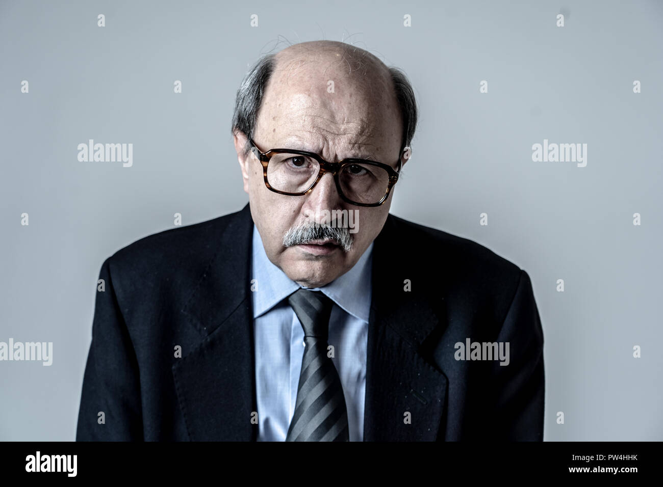 Portrait of senior mature old businessman looking sad and worried suffering pain and depression in sadness face expression Retirement and jobless conc - Stock Image