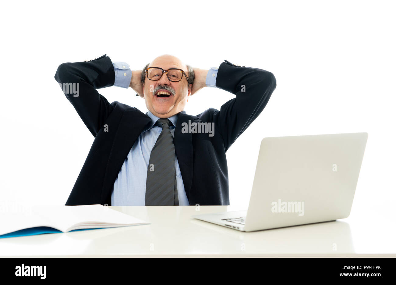 Corporate portrait of happy senior business man confident and satisfied working on computer laptop office desk in Career Success job Satisfaction isol - Stock Image