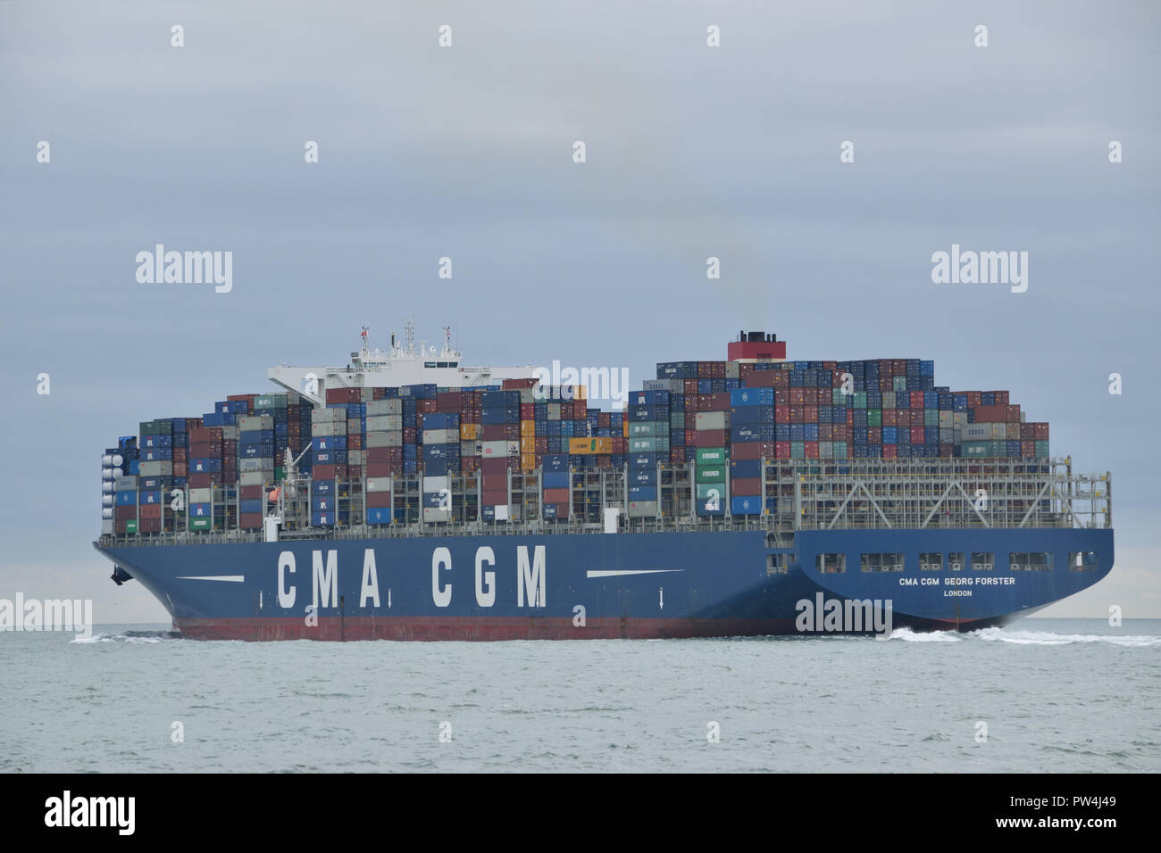 Container Ship CMA CGM Georg Forster seen heading out of the Solent after visiting the port of Southampton - Stock Image