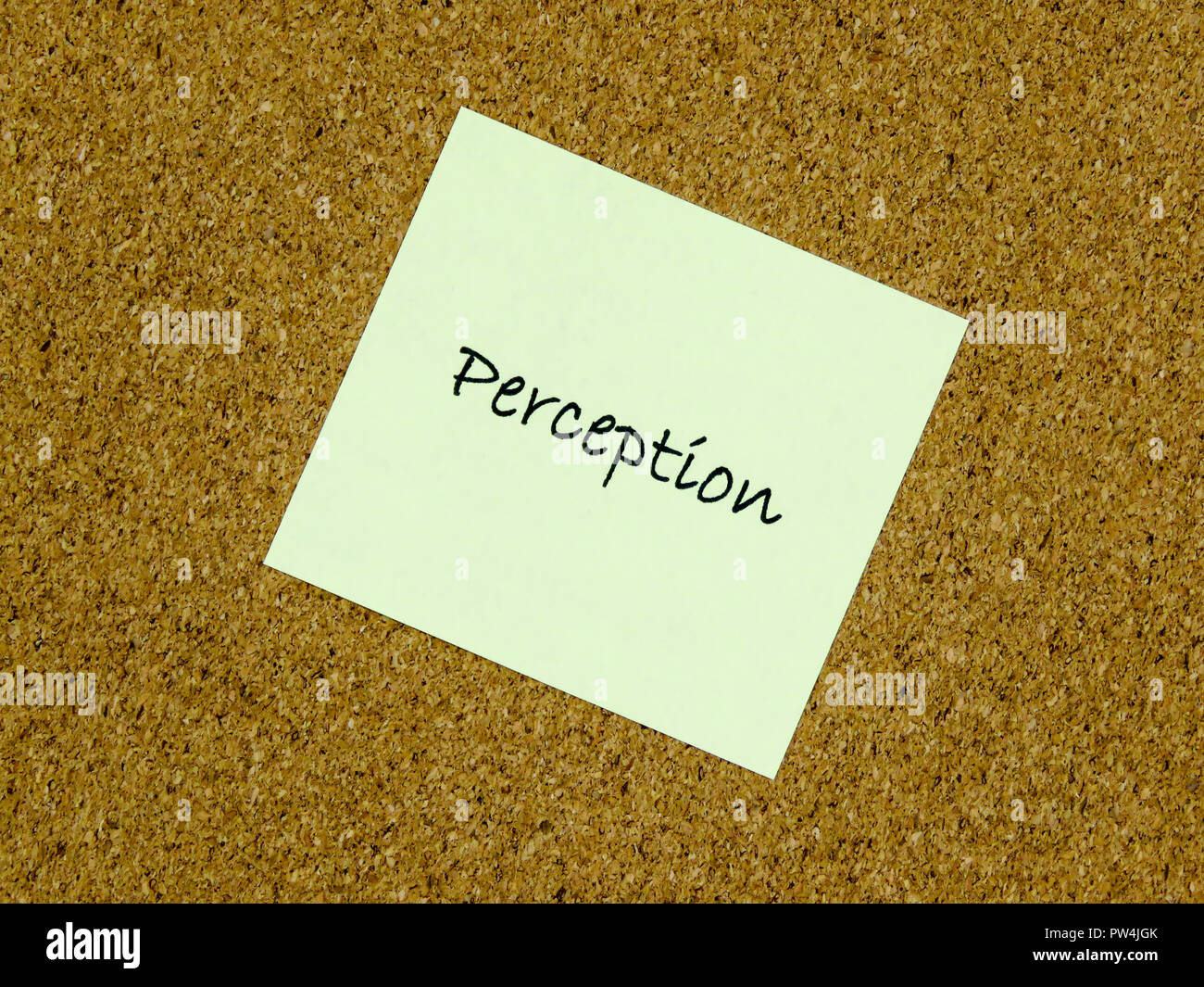 A yellow sticky note with perception written on it on a cork board background - Stock Image