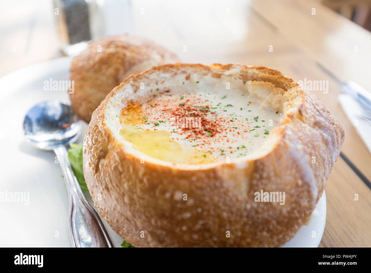 Nothing like a bowl of clam chowder to take the chill out in Cannon Beach, Oregon, USA. - Stock Image