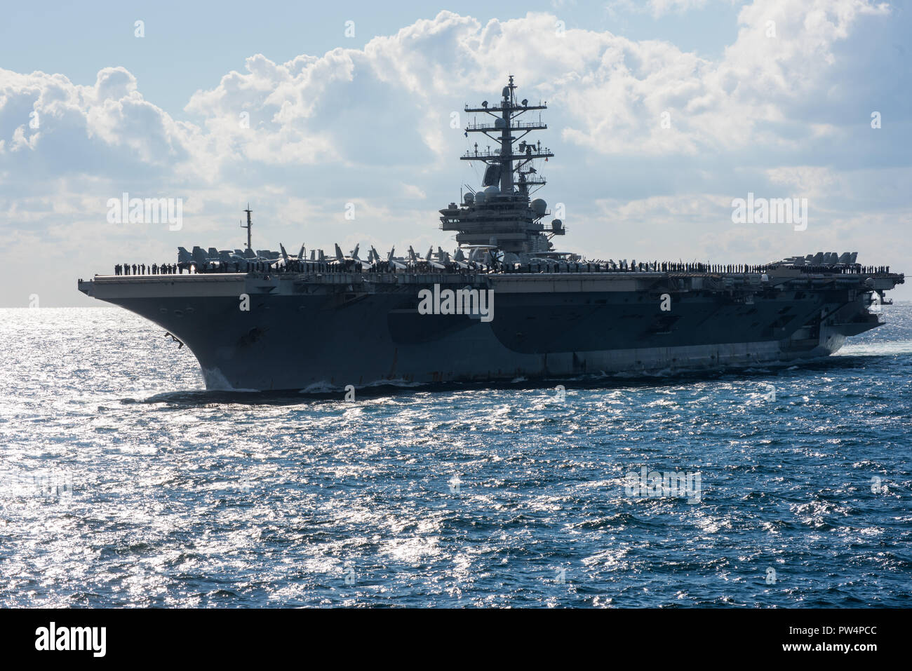 181011-N-TB148-0935 JEJU ISLAND, Republic of Korea, Republic of Korea (Oct. 11, 2018) The nuclear-powered aircraft carrier USS Ronald Reagan (CVN 76) participates in a pass-in-review during the Republic of Korea (ROK) 2018 International Fleet Review (IFR). The IFR is conducted every 10 years and has participants and observers from more than 20 foreign navies. (U.S. Navy photo by Mass Communication Specialist 3rd Class William Carlisle) Stock Photo