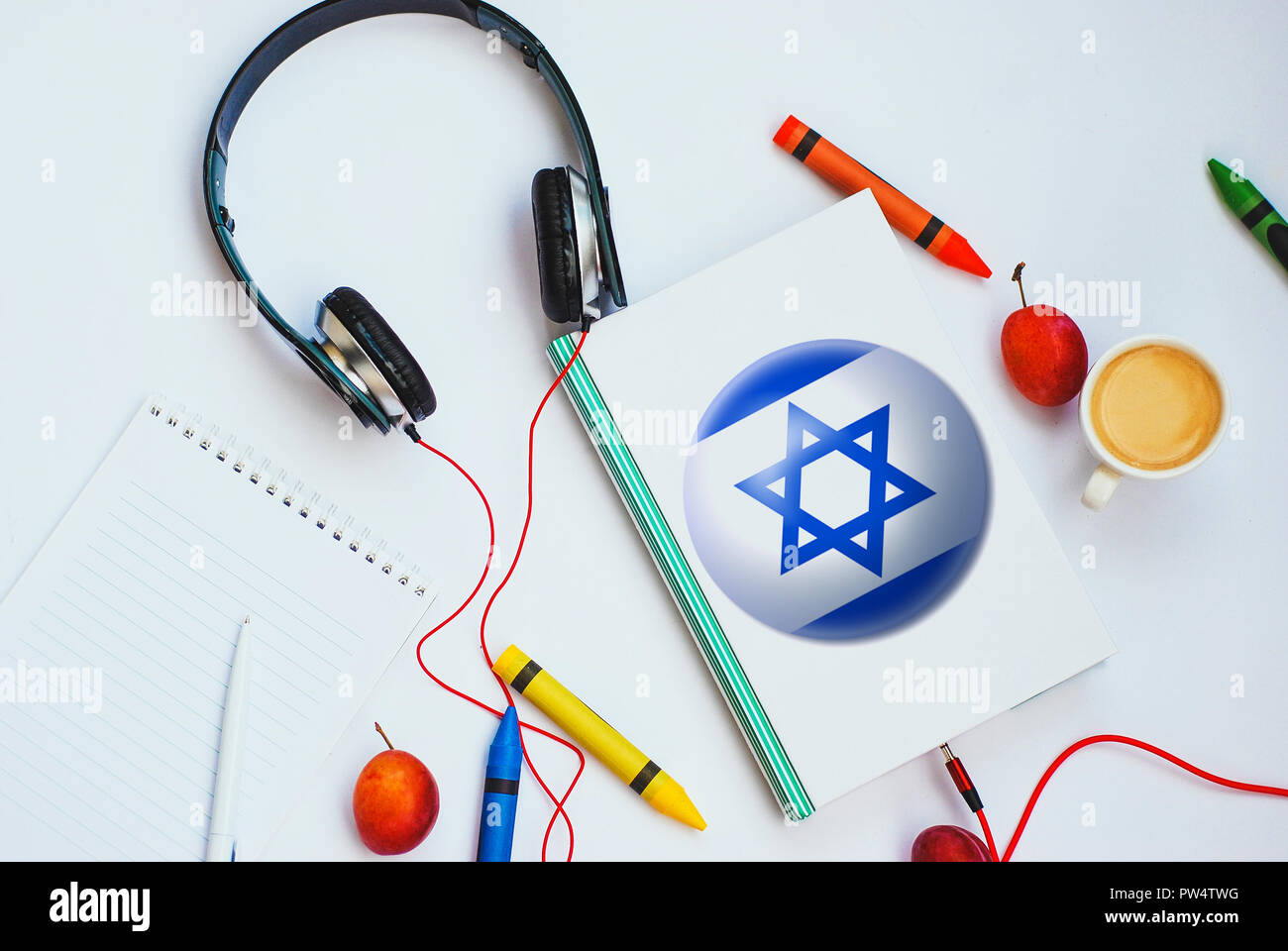 the book with Israel flag and headphones. concept of Hebrew learning through audio courses - Stock Image