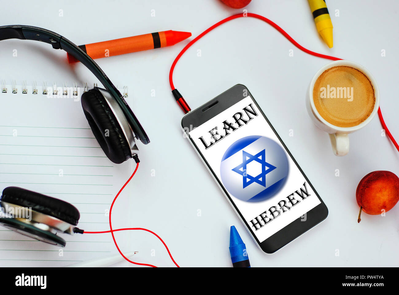 smartphone with Israel flag and headphones. concept of hebrew learning through audio courses - Stock Image