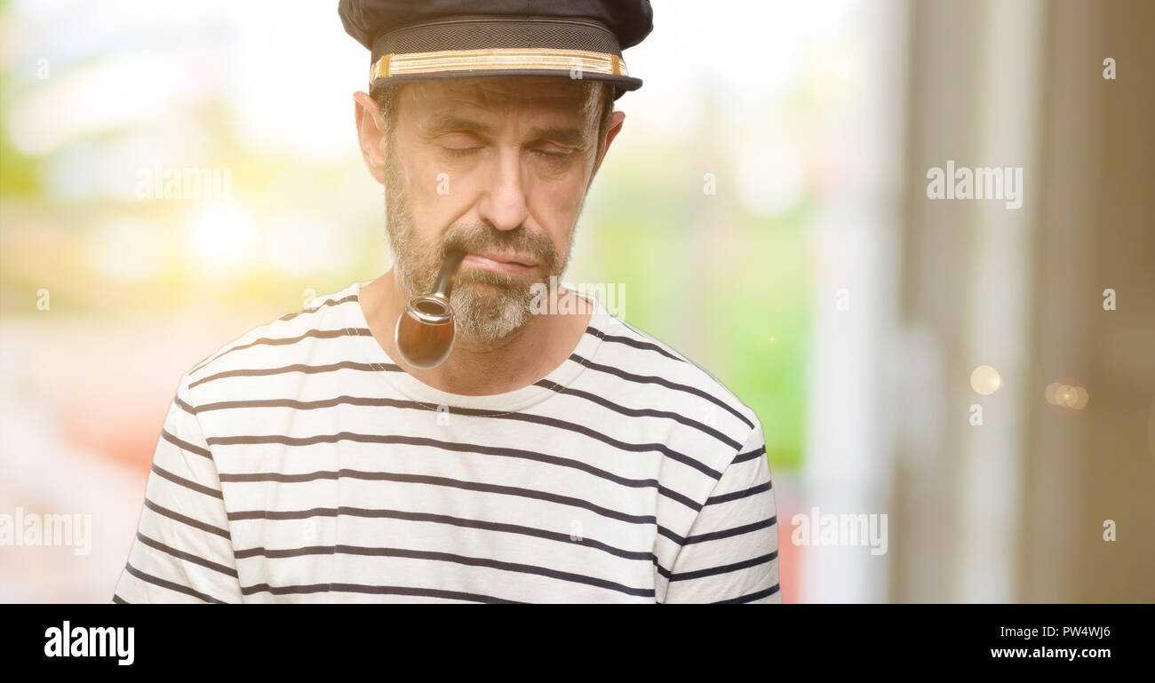 Sailor captain man smoking a tobacco pipe with sleepy expression e82cc1381736
