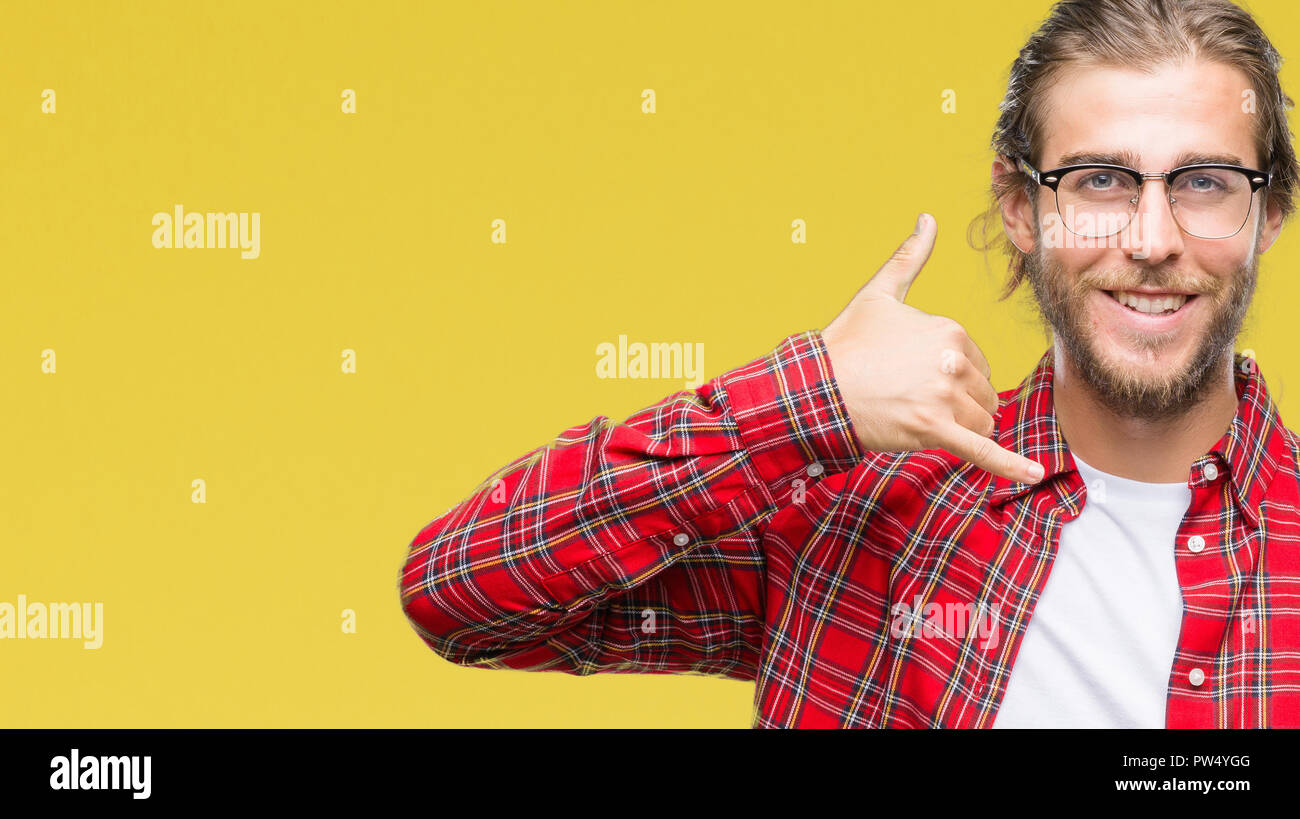 Young Handsome Man With Long Hair Wearing Glasses Over Isolated Background Smiling Doing Phone Gesture