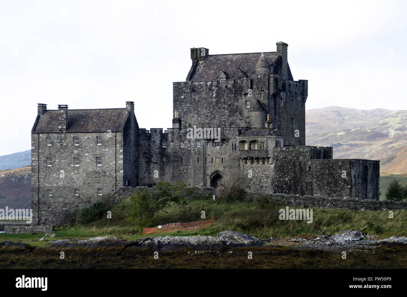 This is Eilean Donan castle which sits on a small island in Loch Duich, Scotland. It dates back to the 13th century, has been restored, is one of the most photographed, and visited, castles in Scotland. It has appeared in feature films a few times. - Stock Image