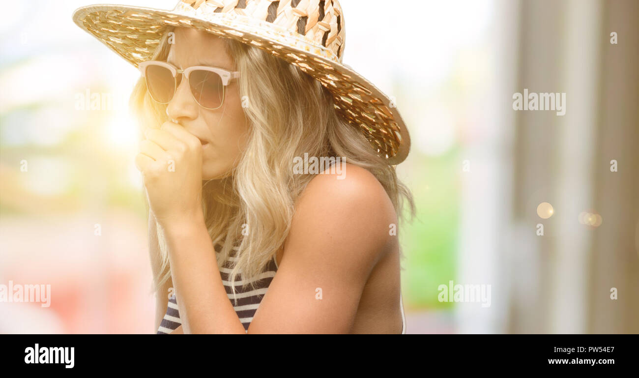 Young woman using sunglasses wearing summer hat sick and coughing, suffering asthma or bronchitis, medicine concept - Stock Image