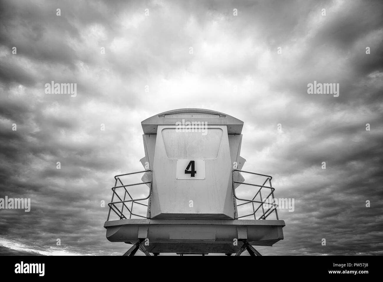 San Diego, California, USA. Close up of a lifeguard tower against a dramatic sky. - Stock Image