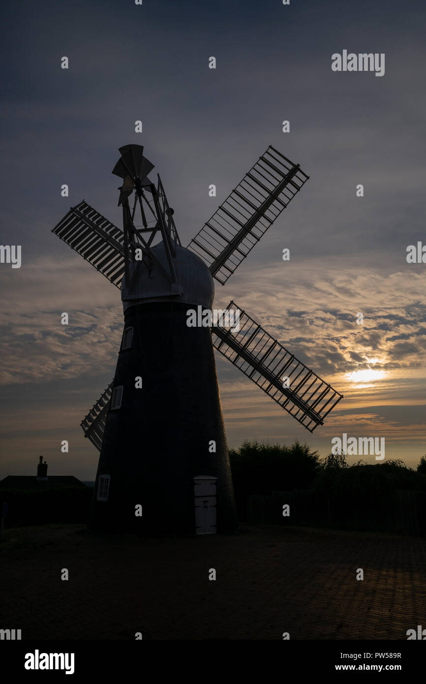 Ellis Mill, part of the UK's industrial heritage, silhouetted against evening sunlight, Lincoln Edge, Lincoln, UK Stock Photo