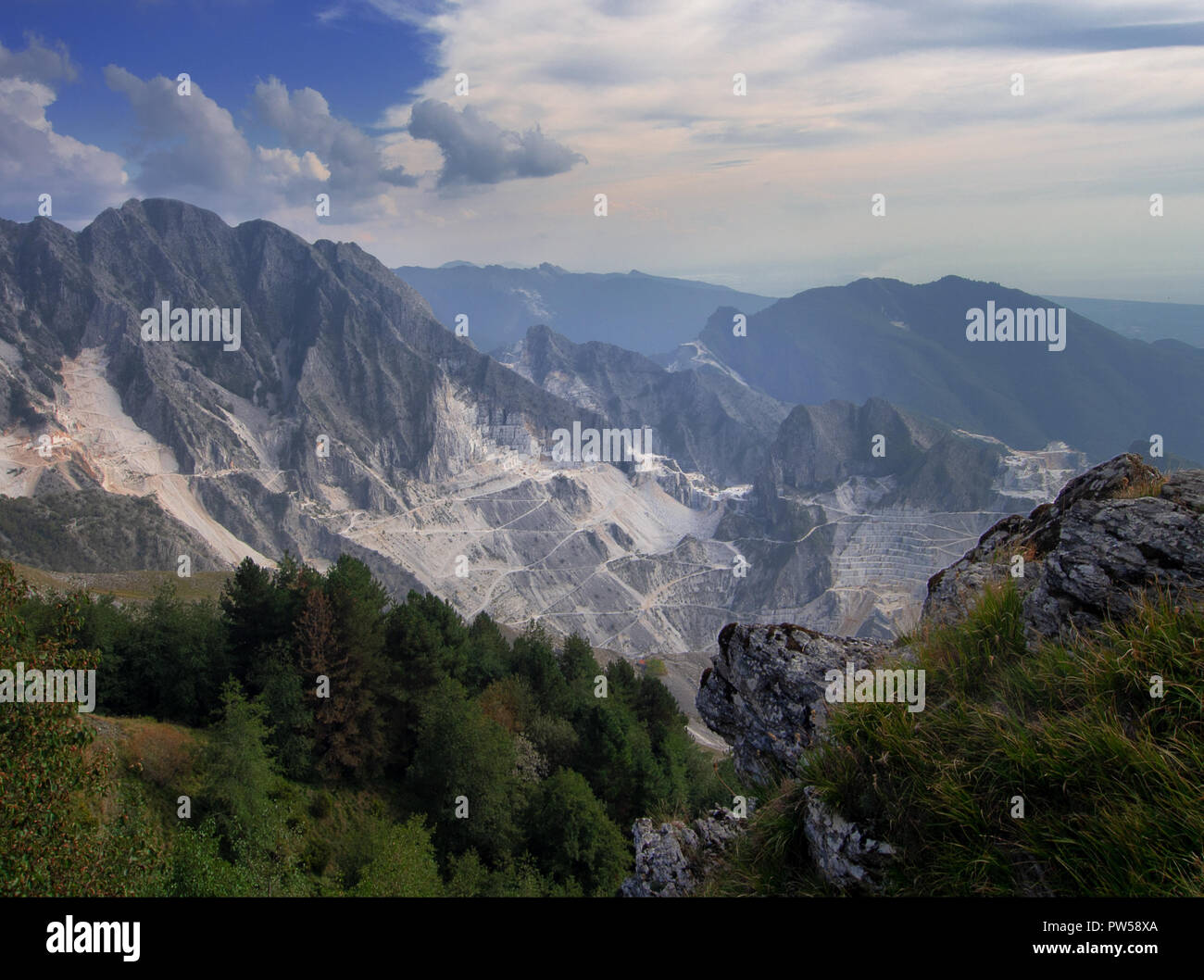 Stunning wide view over the white marble quarries seen from Campo Cecina, Massa Carrara, Italy. Autumn, fall. Beautiful landscape but also environmental issues. - Stock Image
