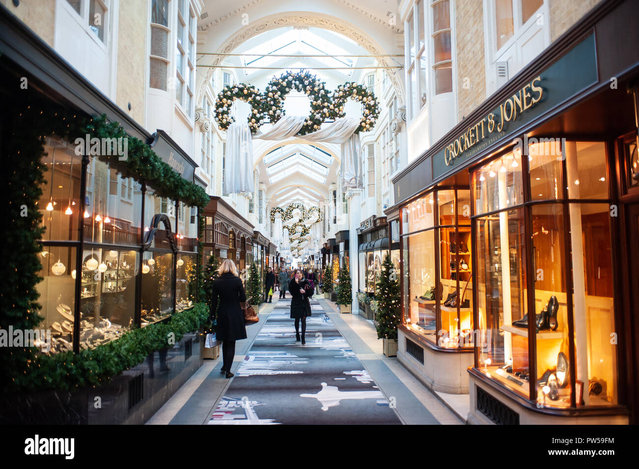 LONDON, UK - NOV 21: people stroll in the Burlington Arcade in London on November 21, 2013. It is one of the best-known London shopping arcades at Chr - Stock Image
