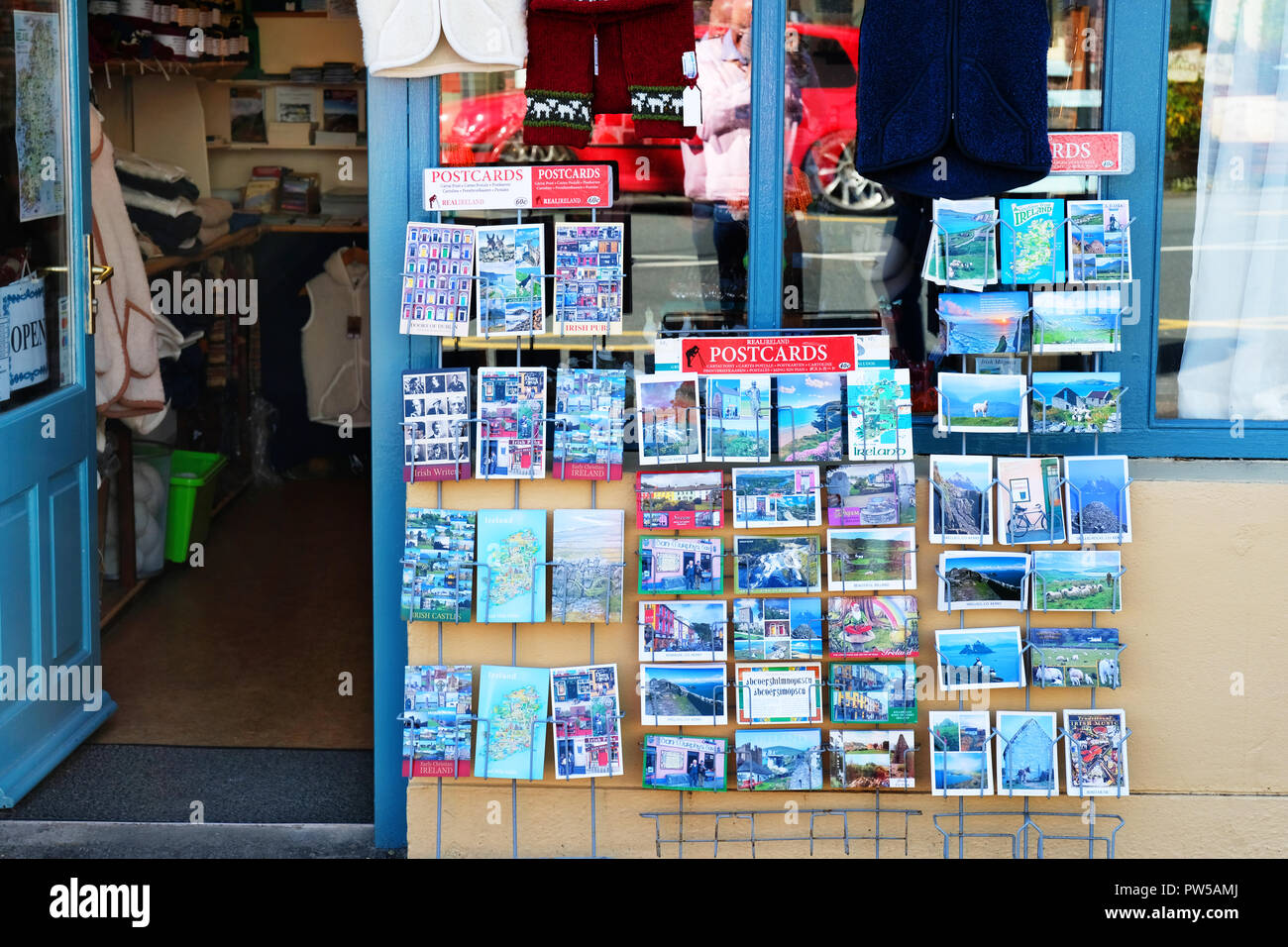 Outdoor display of postcards outside a tourist shop on the Ring of Kerry, Ireland - John Gollop - Stock Image