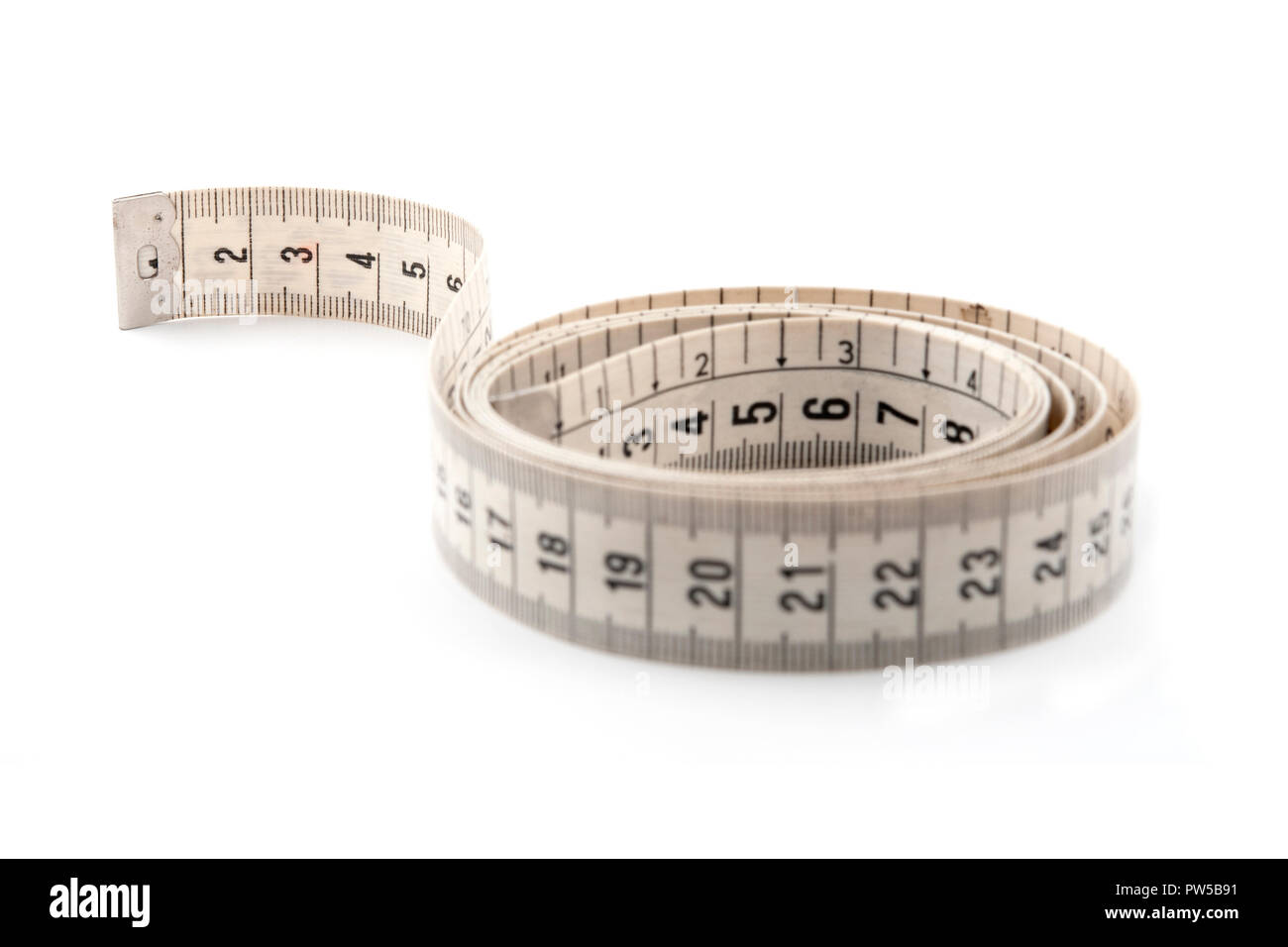 Cloth tape measure on a white backgroud - Stock Image