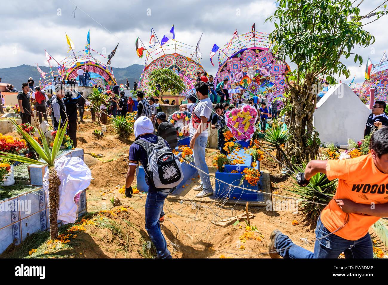 Santiago Sacatepequez, Guatemala - November 1, 2017: Flying kites during Giant kite festival honoring spirits of dead in cemetery on All Saints Day. - Stock Image