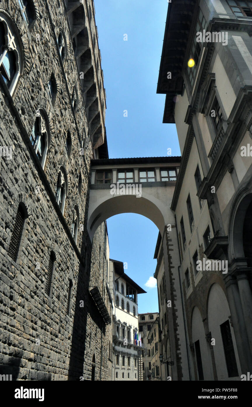 FLORENCE, ITALY - JUNE 12, 2016: The narrow streets of the old of Cortona, with the transitions between the houses. Tuscany, Italy - Stock Image