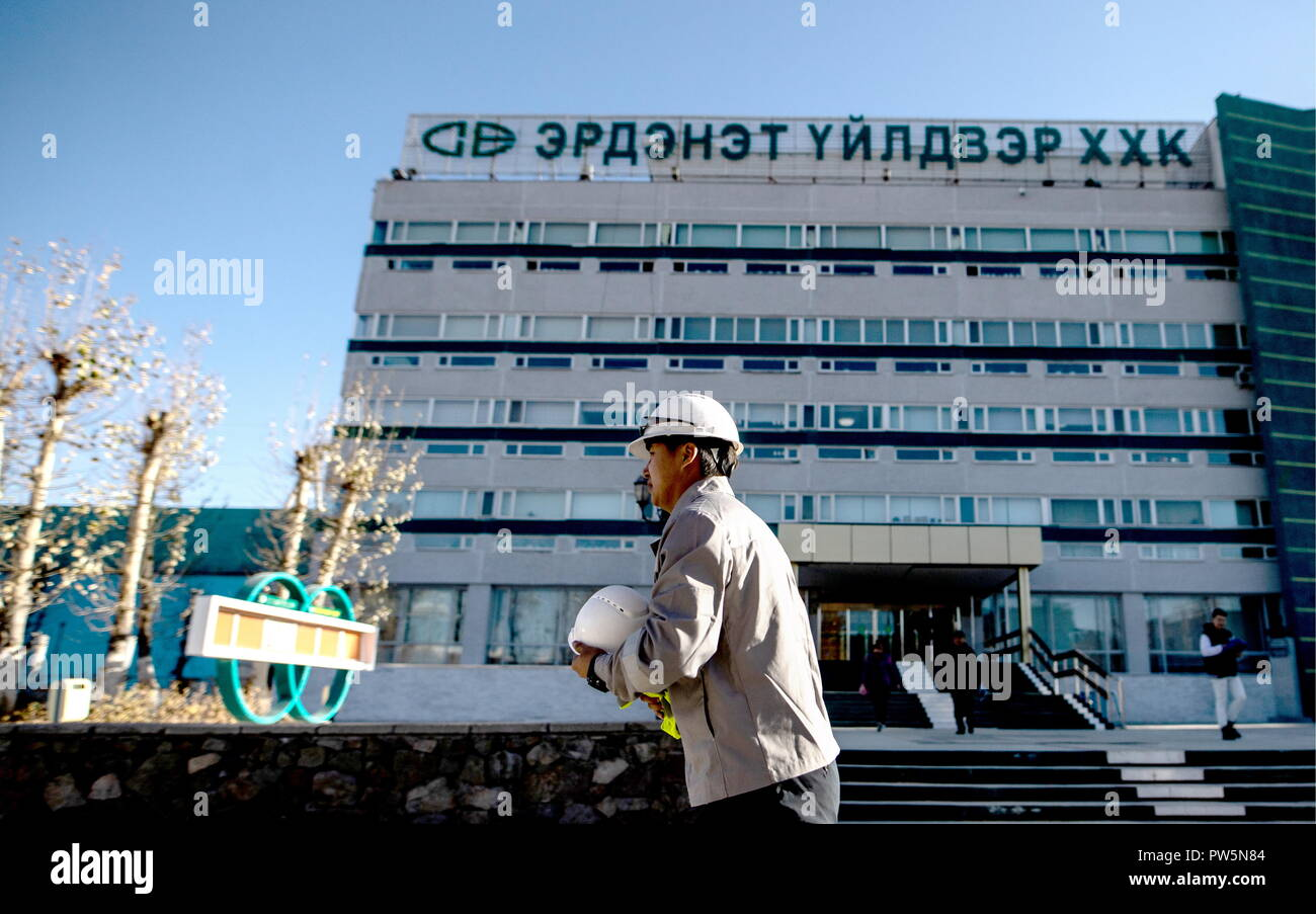 ERDENET, MONGOLIA - OCTOBER 11, 2018: A worker outside an office building of an ore processing complex operated by Erdenet Mining Corporation (EMC), a major manufacturer of copper concentrate and molybdenum concentrate. Sergei Bobylev/TASS - Stock Image