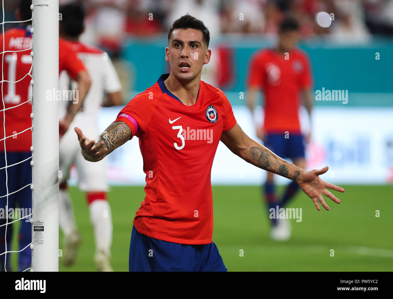 Miami Gardens, Florida, USA. 12th Oct, 2018. Chile defender ENZO ROCO (3) reacts to team-members after his auto-goal during an international friendly match between the Peru and Chile national soccer teams, at the Hard Rock Stadium in Miami Gardens, Florida. Credit: Mario Houben/ZUMA Wire/Alamy Live News - Stock Image