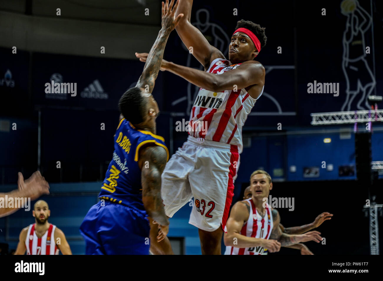 Zach LeDay, #32 of Olympiacos Piraeus in action against #3, Dee Bost, of Khimki Moscow in the Turkish Airlines Euroleague Opening round of the 2018-2019 season. (Olympiacos Piraeus defeated Khimki Moscow Region 87-66) - Stock Image