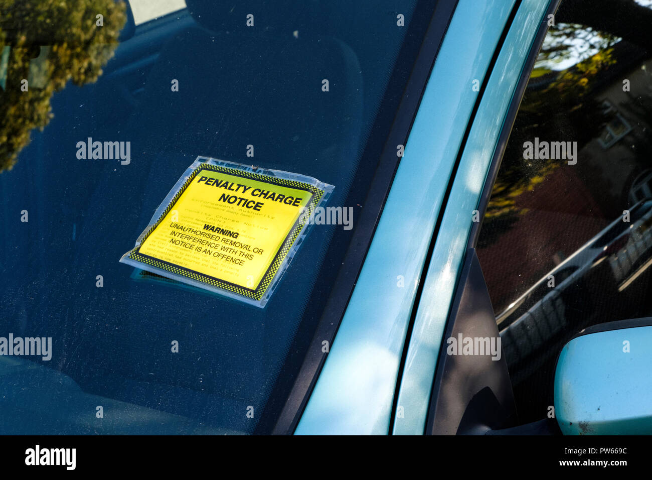 Parking fine. A Penalty Charge Notice stuck on a car windscreen, Lincoln, England, UK - Stock Image