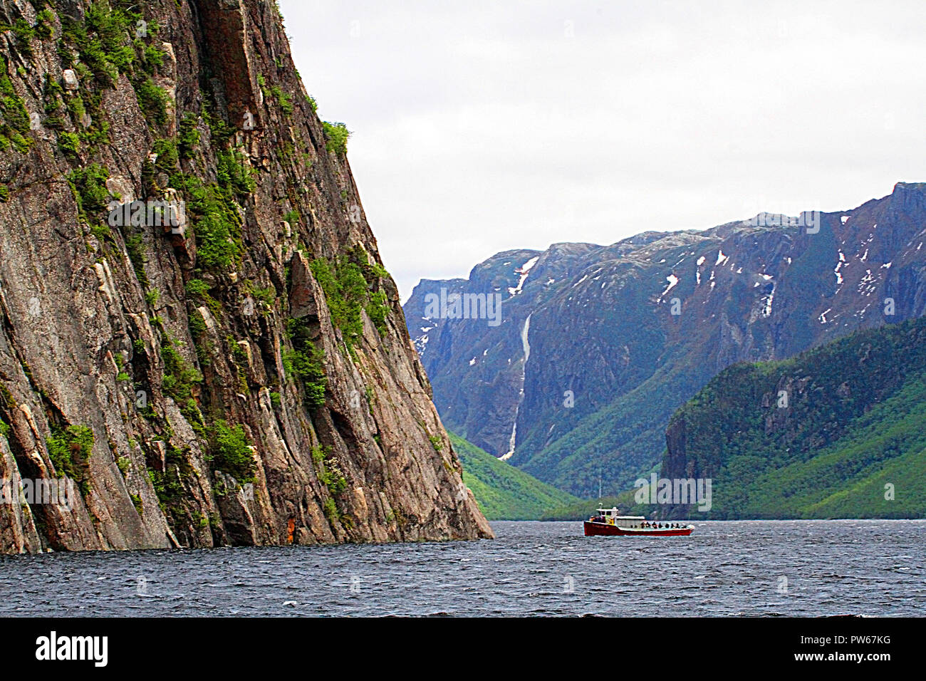 Western Brook Pond and Gros Morne National Park, Newfoundland, Canada,  tour boat  and Tabletop Mountains, inland fjiord - Stock Image