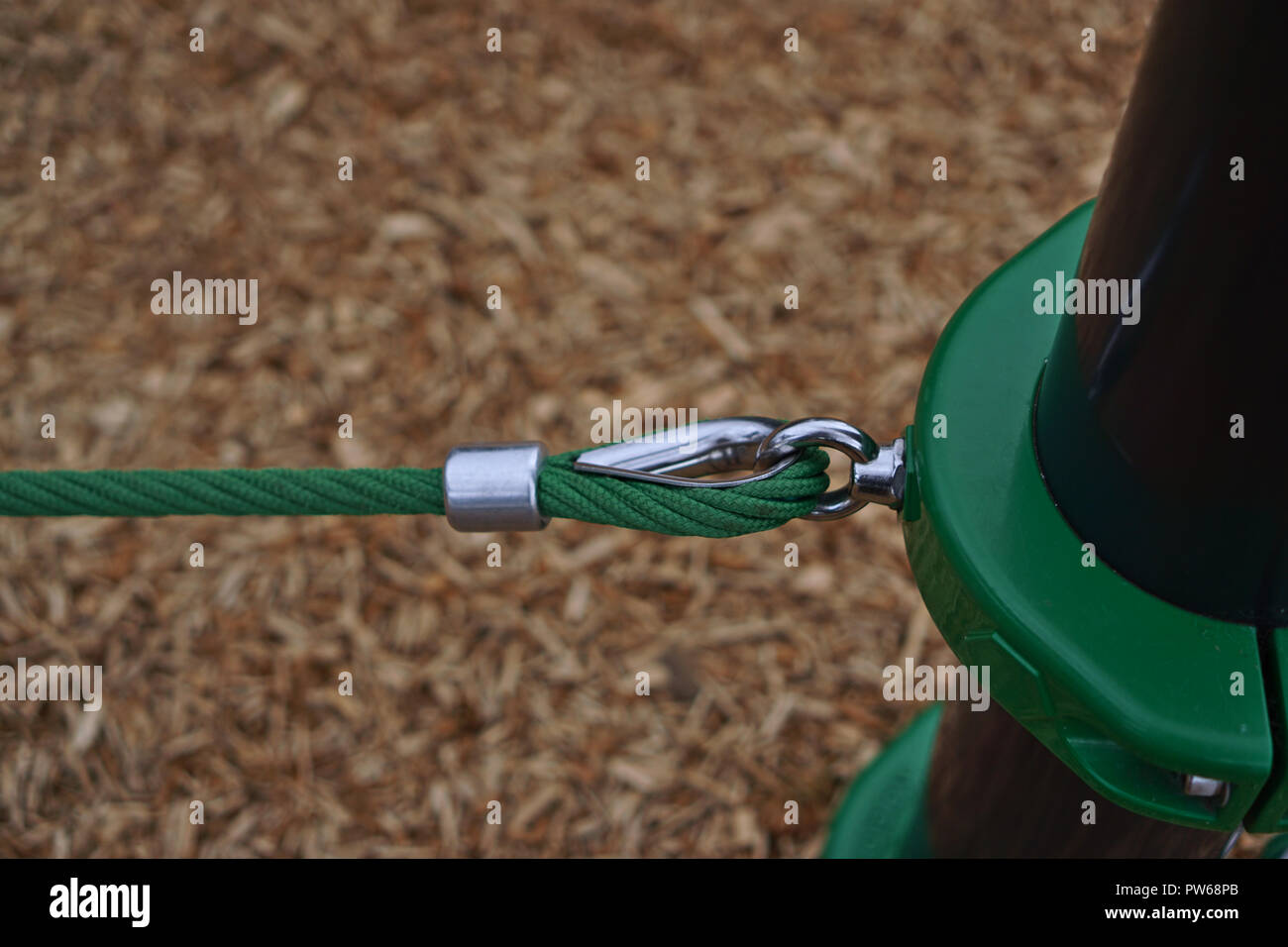 Green ropes with a metal hook fastener - Stock Image