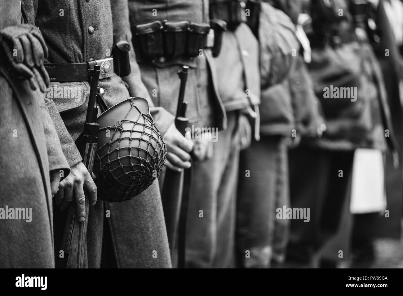 Close Up Of German Military Ammunition Of A German Soldier. Unidentified Re-enactors Dressed As World War II German Soldiers Standing Order. Photo In  - Stock Image