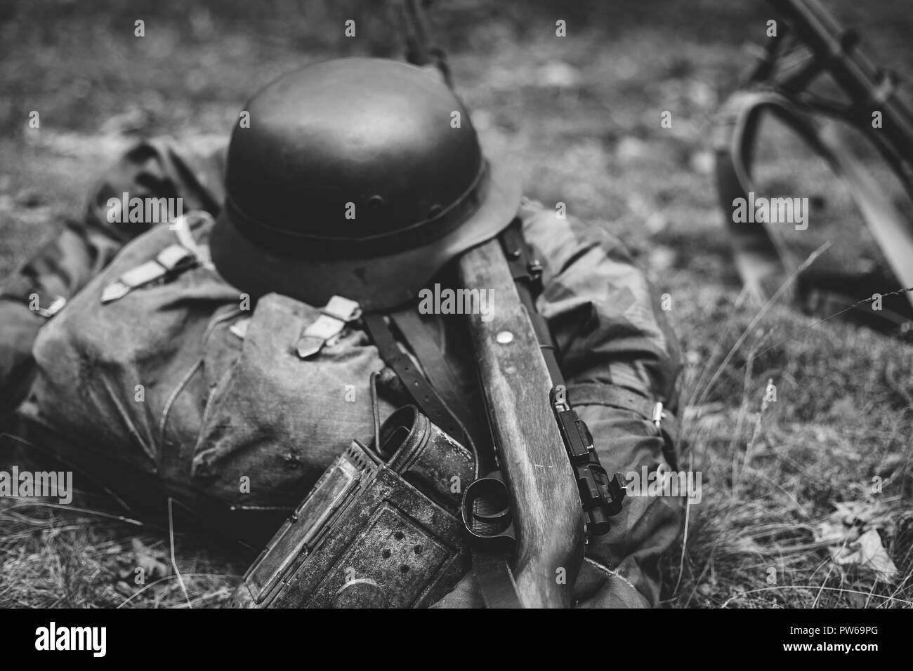 German military ammunition of world war ii on ground military helmet lights rifle photo in black and white colors
