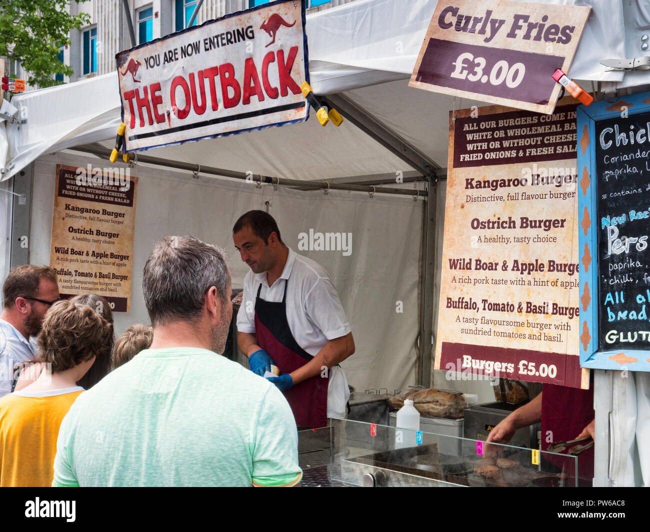 2 June 2018: Plymouth, Devon, UK - Customers gathered around a food stall selling kangaroo burgers at Flavour Fest, Plymouth, Devon, UK - Stock Image