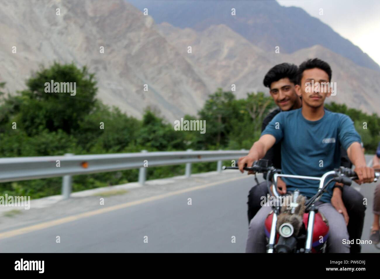 hunza boys ride bike - Stock Image