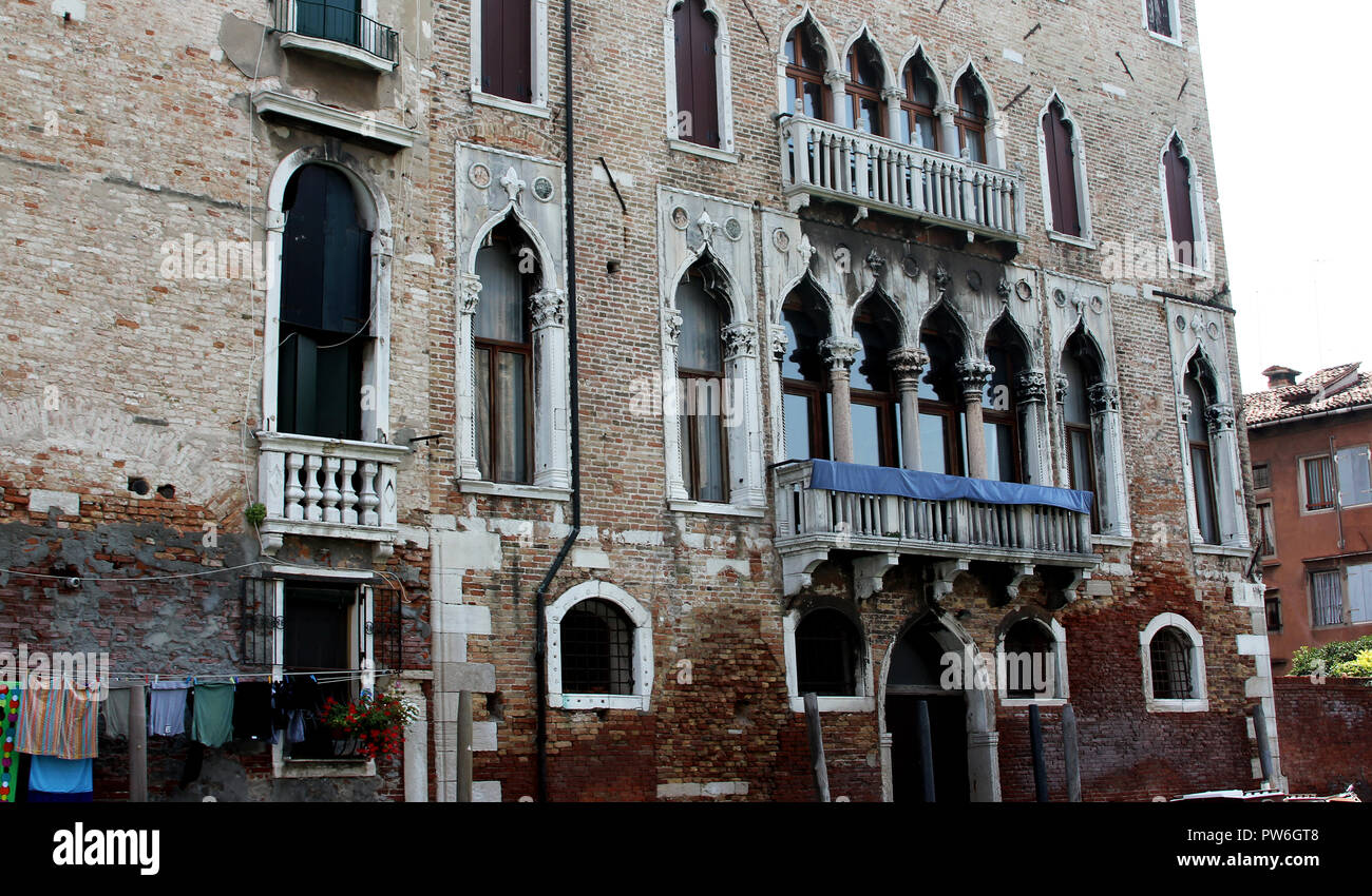 The level of water intrusion and rising damp can be seen here on a building in the Italian city of Venice which is built on canals and marshes. - Stock Image