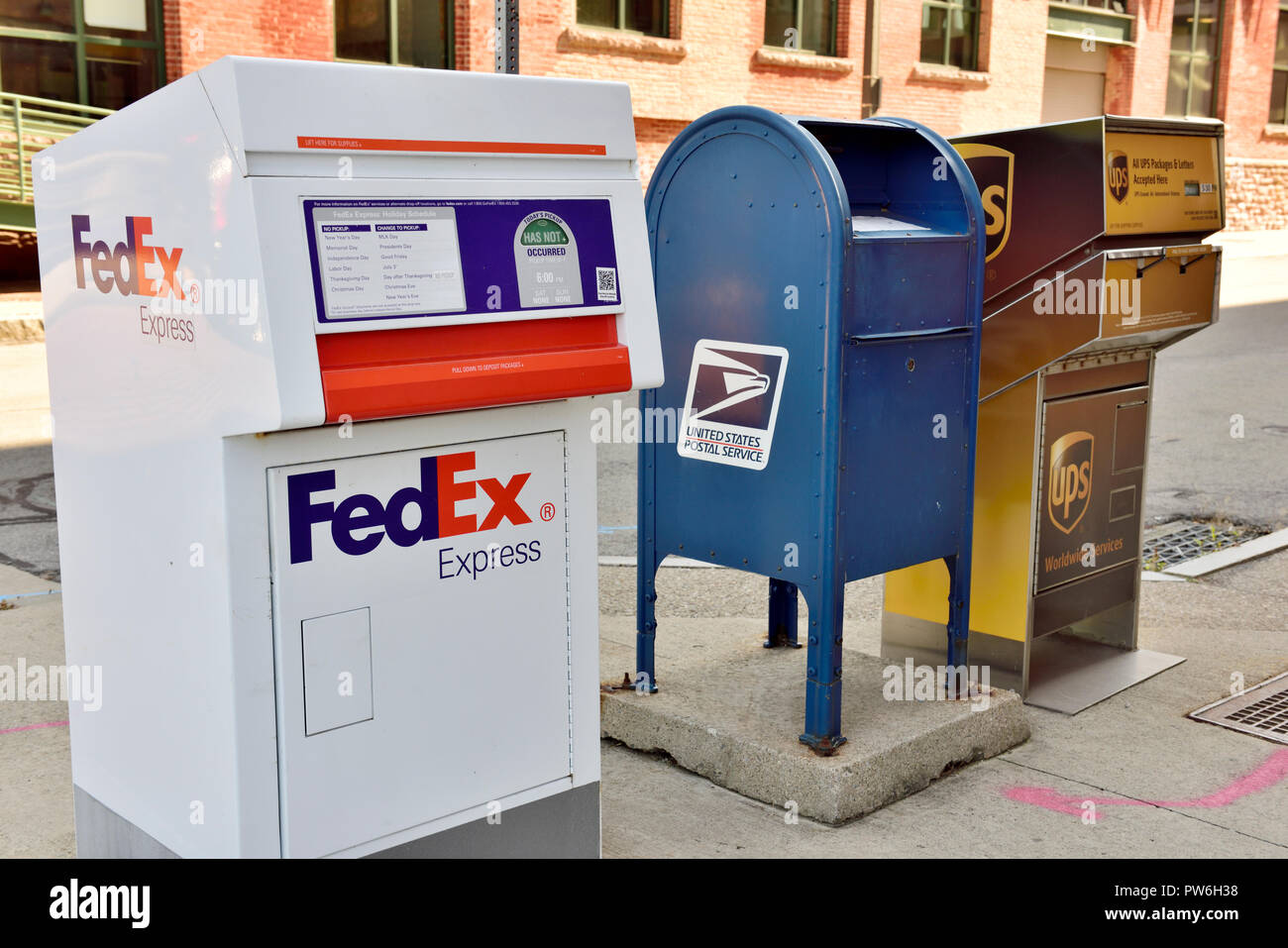 FedEx, US Postal and UPS drop off  for collection posting boxes on sidewalk, USA - Stock Image