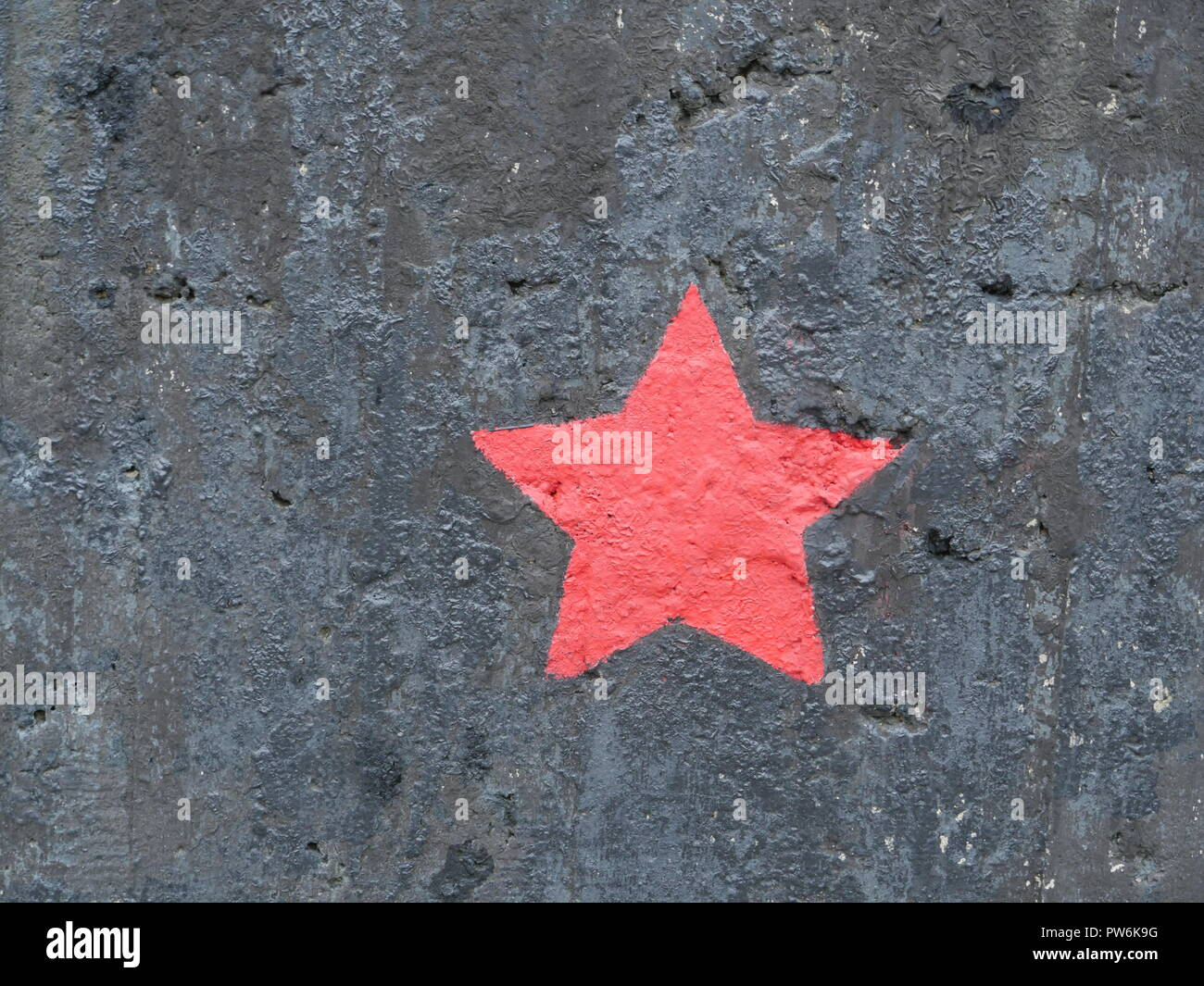 five-pointed red star on a black background - Stock Image