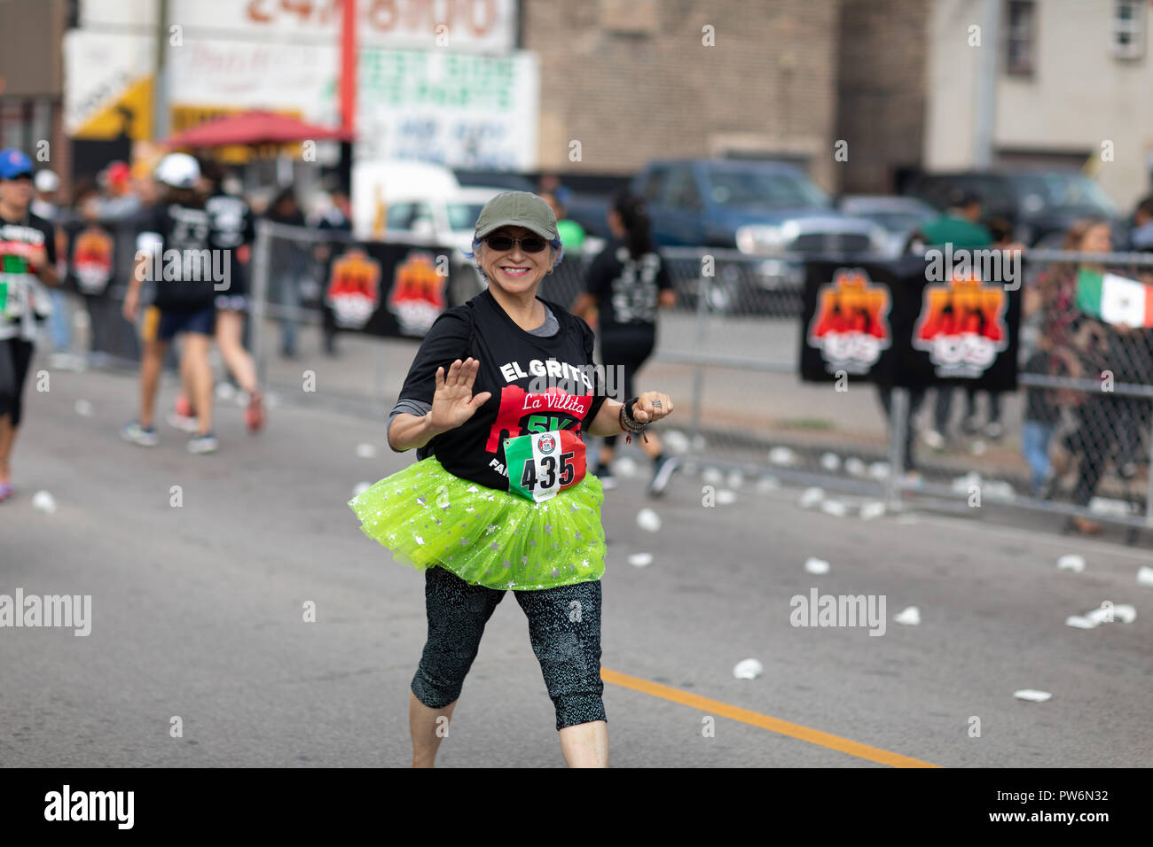 Chicago, Illinois , USA - September 9, 2018, El Grito 5K at la Villita, family run walk, men and women running in the annual 5 kilometers race, prior  - Stock Image