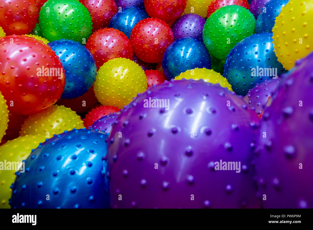 many kick balls together in one area wall to wall - Stock Image