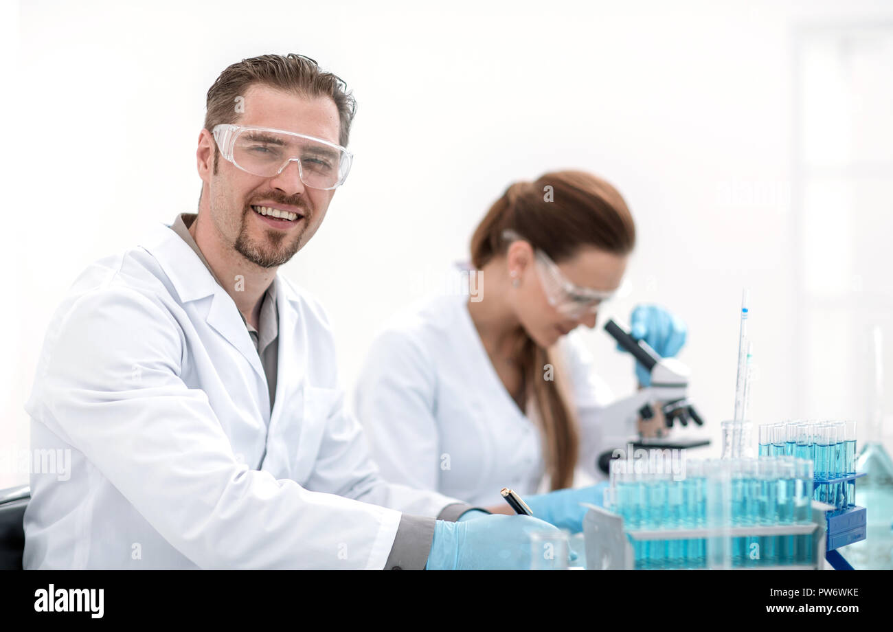 two scientists biologists sitting at the laboratory table - Stock Image