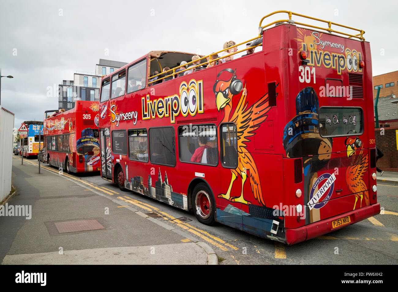 open top tours red city sightseeing tour busses in the knowledge quarter Liverpool merseyside england uk - Stock Image