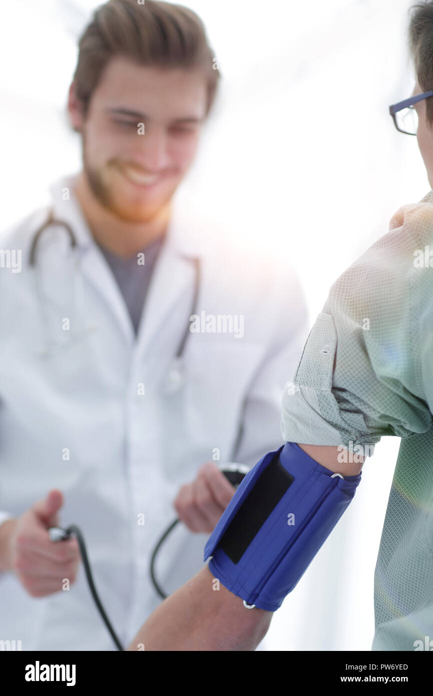 therapist measures the pressure of the patient. - Stock Image